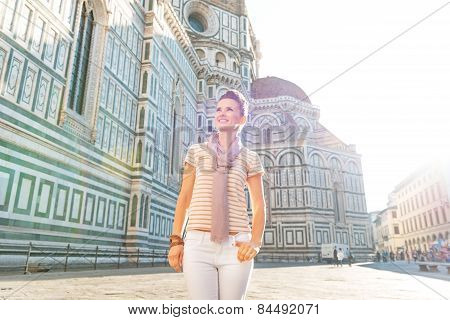 Happy Young Woman In Front Of Cattedrale Di Santa Maria Del Fiore In Florence, Italy