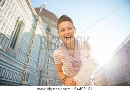 Portrait Of Smiling Young Woman With Map In Front Of Cattedrale
