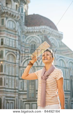 Happy Young Woman With Map Looking Into Distance In Front Of Cattedrale Di Santa Maria Del Fiore In