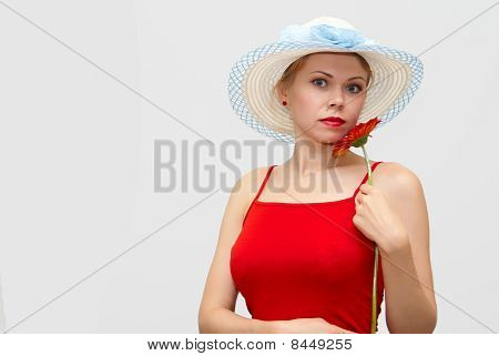 Girl In A Hat And With A Flower