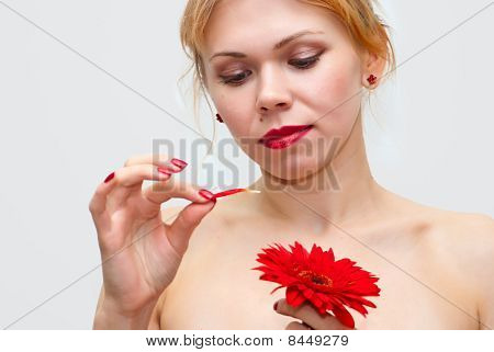 Guessing On A Flower Tearing Off Petals