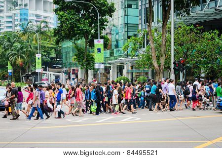 Pedestrians On Famous Street Orchard Road In Singapore