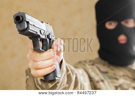 Man In Black Mask Holding Gun And Ready To Shot