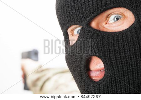 Crazy Man In Black Mask Holding Gun