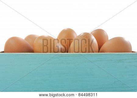egg in blue wood box