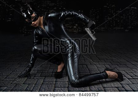 Sexy female in black catwoman costume