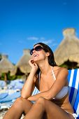 stock photo of mayan  - Joyful woman at tropical resort caribbean beach looking up to the blue sky - JPG