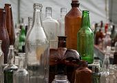 stock photo of yard sale  - Assorted bottles at a yard sale in the united states - JPG