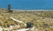picture of four-wheel drive  - Gravel road to the beach with four wheel drive in Spain - JPG