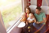 stock photo of passenger train  - Family with two sons travel in train - JPG