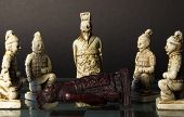 stock photo of king  - Dead black king lying in front of white king and his soldiers.