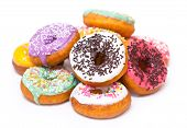 pic of white sugar  - Colorful fresh doughnuts with icing on the white background - JPG