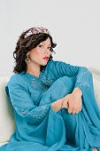image of yashmak  - Beautiful Adult arabian woman in blue abaya - JPG