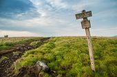 image of appalachian  - An aged wooden sign marks the elevation of Round Bald on the Appalachian Trail near the border of Tennessee and North Carolina - JPG