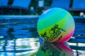 stock photo of pool ball  - A bright color Beach ball in the children - JPG