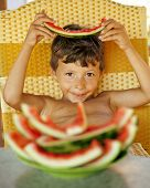 foto of crust  - cute young little boy with watermelon crustes smiling - JPG