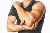 stock photo of elbow  - Man holds his the elbow joint - JPG