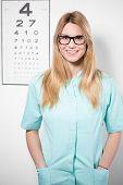 pic of snellen chart  - Image of smiling female optician wearing glasses - JPG
