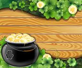 stock photo of gold panning  - Leprechaun pot with gold coins and clover on wooden background - JPG
