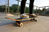 pic of skateboarding  - young skateboarder legs skateboarding at skatepark ramp - JPG