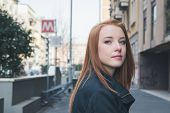 picture of redhead  - Beautiful young redhead girl posing in the city streets - JPG