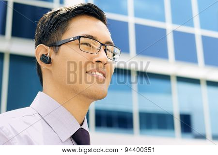 Business Man With Wireless Handsfree Device Text Space