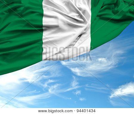 Nigerian waving flag on a beautiful day