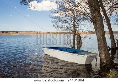 Wooden boat on the lake in the spring