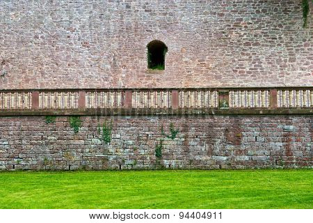Architectural Detail of Exterior Stone Wall, Railing and Green Grass on Grounds of Heidelberg Castle, Baden-Wurttemberg, Germany