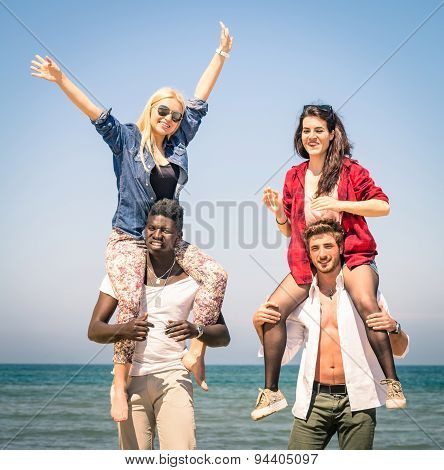 Multiracial Best Friends At Beach Having Fun With Piggyback Game - Spring Summer Concept