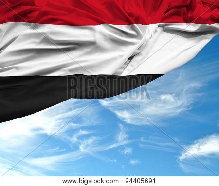 Yemen waving flag on a beautiful day