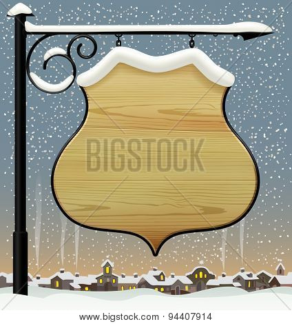 Vintage wooden street  signboard hanging on forged brackets against the winter old city. background