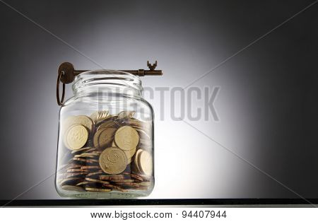 key on top of the saving jar