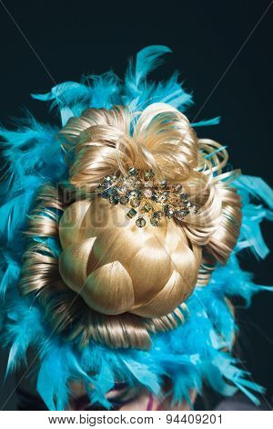 Creative Hairstyle From Hairpices. Pineapple In Feathers