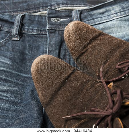 clothes set close-up leather shoes on jean pant