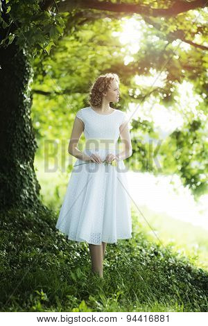 Woman Standing Near Tree In A Park