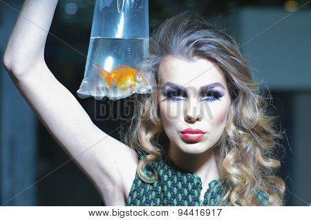 Sriking Girl With Goldfish