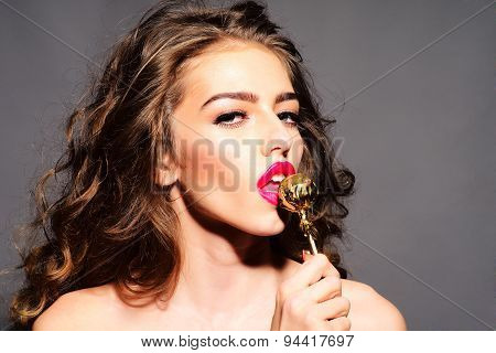 Bewitching Woman With Gold Round Lollipop