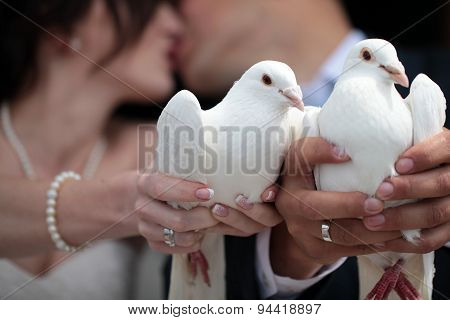 Married Couple With White Pegeons