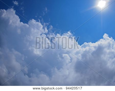 Dark Clouds, Blue Sky And Bright Sun