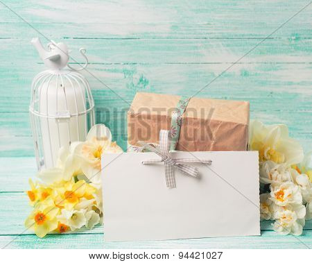 Postcard With Daffodils Flowers, Gift Box, Candle And Empty Tag For Text