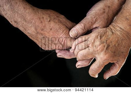 Wrinkled Hands Of Two People
