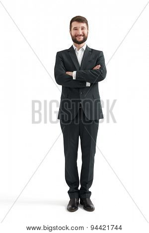 full-length portrait of smiley businessman in formal wear with folded hands looking at camera. isolated on white background