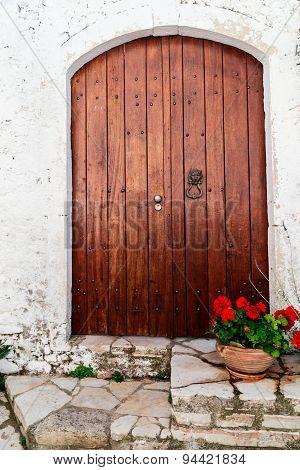 wooden door on traditional greek house