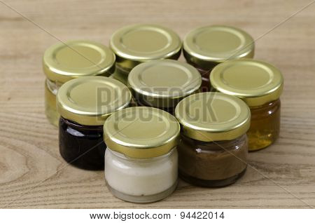 Eight Small Jars Of Honey Of Differents Flavors