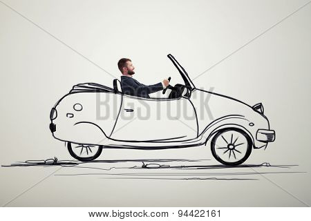 smiley man sitting in drawing car and driving on the drawing road over grey background