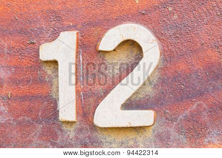 Closeup Number 12 On Red Wooden Sign Board In Thailand