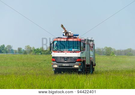 BORYSPIL, UKRAINE - MAY, 20, 2015: Fire-brigade on firetruck Mercedes with water cannon ride on alar