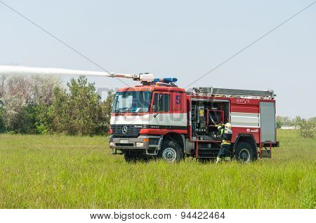 BORYSPIL, UKRAINE - MAY, 20, 2015: Fire-brigade on Fire Engine Mercedes using a water cannon during