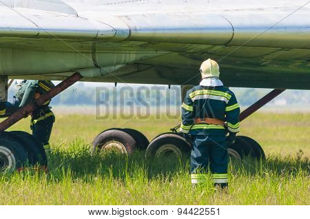 BORYSPIL, UKRAINE - MAY, 20, 2015: Firefighters train for battling an aircraft fireat Boryspil Inter